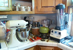 Kitchen items including Hobart KitchenAide stand mixer and Vitamix 5000 blender.