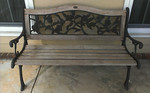 One of a pair of iron and wood benches.