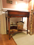 Modern plantation style desk with mechanized opening and closing hinge.