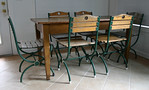 Farm/work table with 6 slatted cafe chairs.