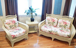 Pier One wicker.  The cushions shown are original and unused.  The owner also has more contemporary black and white cushions that can be interchanged for a more contemporary look.  