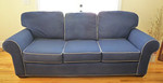 Clean navy blue sofa w/contrasting piping