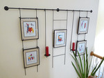 Art display rack.  ART IS NOT FOR SALE and is only shown for demonstrative purposes.