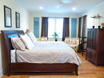 King contemporary bed w/leather headboard