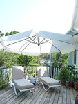 Large, tilt-able patio unbrella and a pair of loungers.  Umbrella cost $300 new.  Very good cosmetic and working condition.