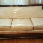 This sofa has spent it's entire life wrapped in plastic.  Fabric is super clean!