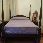 Clean, affordable queen four poster bed.
