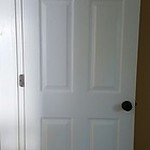 Door with hinges and knobs