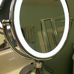 One of a two lighted makeup mirrors.