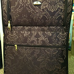 Large set of luggage that includes smaller suitcases inside and other unused pieces.  Actual color is purple.