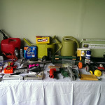 Misc. tools, small flat panel TV stand w/box, sprinklers, etc