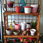 Clean rattan etegere/baker's rack with assorted goods
