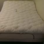 Super clean, barely used Sealy full size adjustable bed.  Both the foot and head adjust up and down via wired remote.