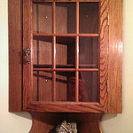 Small, wall mounted corner cabinet