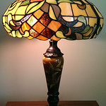 Pair of quality stained glass lamps with hand painted, ceramic bases