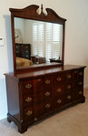 Cherry dresser with mirror, light wear to top surface.