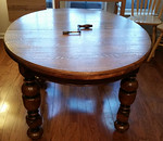 Great looking antique oak table with crank mechanism.  Note the fantastic legs!