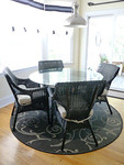Pier One rattan dining table with 4 Pier One wicker chairs.