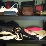 Large, quality metal shelf with handbags.