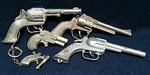 Old Pal cap guns, key chain cap gun and small derringer style cap gun.