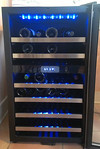 Working Kenmore wine chiller, with slide out storage drawers, shown open.