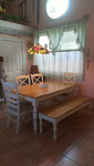 Kitchen table, chairs and bench.