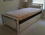 Retro, campaign style captain's bed.  Perfect for a child's room and not the everyday furniture!