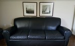 Mitchell Gold leather sofa that has spent the last 8 years under slip cover.