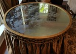 Large mirrored accent table with custom skirt and glass