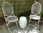 Pair of iron outdoor chairs
