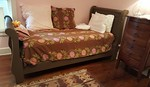 Twin sleigh bed dressed up like a day bed