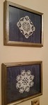 Pair of framed lace doilies