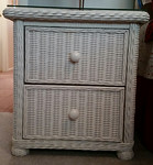 Pair of wicker nightstands.  Who took this crooked photo?