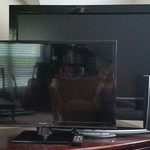 """Flat panel TV's.  2013 Panasonic 32"""" in front was used for one playoff game and was still wrapped in plastic in the box.  Rear TV is 2007 Insignia 42"""" LCD."""