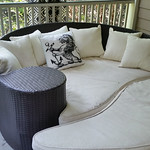 All-weather wicker, only 8 months old.  Lion pillow is from One Kings Lane.