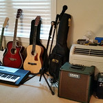 Children's starter guitars, Crate amp, smaller amp, mic w/stand.  (Guitar on far right is not available.)