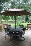 Cast aluminum table, 4 chairs and umbrella