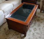 Great coffee table with felt lined interior drawer for displaying curiosities.