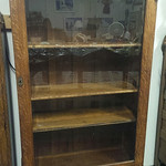 Oak curio cabinet with lower drawer
