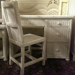 Wicker desk with custom glass top and matching chair.  Perfect for beach home or girl's room.