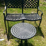 Excellent condition, heavy iron settee and table