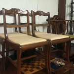 Set of (6) chairs (only four are shown) and contemporary game table with some wear to top.