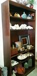 Mahogany bookshelf with additional shelf not shown.