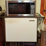 Working fridge on marching cart, clean microwave and toaster oven