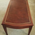 "Leather top mahogany cocktail table, 40"" x 20"""