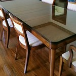 European dining table with leaves and custom glass for each leaf